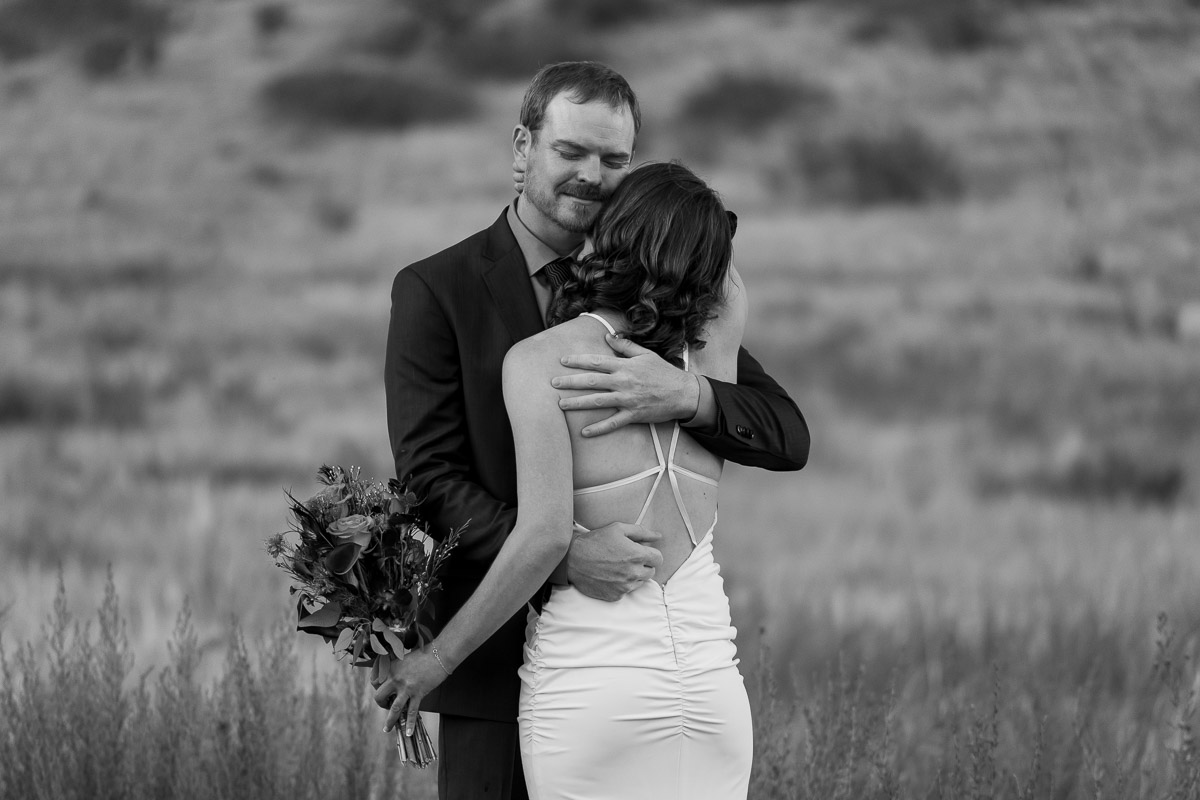 adventurous Colorado mountain wedding photographers couple portraits in a field